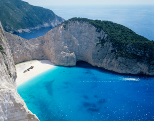 Aerial view of Navagio Beach and Shipwreck of the Panagiotis at 'Smugglers Cove' on the coast of Zakynthos in the Ionian Islands Courtesy: Creative commons